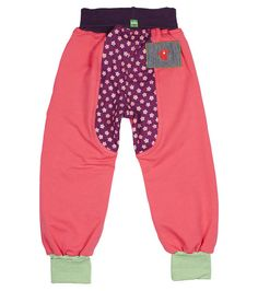 Gorgeous french marle pink trackies with purple flowered bottom panel and tummy toastie. Green rib ankle cuffs and front pocket details. Super trendy track Pants.  These awesome 'big' trackies will accommodate any little lady's play day needs. We are loving the More to Life Track Pants!  All Oishi-m Trackies feature our 'Tummy Toastie' meaning that not only will these pants accommodate growth in leg length, they will also accommodate our little people around the waist too.