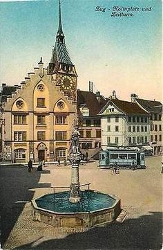 Zug Switzerland 1908 Kolin Plaza Clock Tower Antique Vintage Postcard Zug Switzerland Circa 1908 Kolin Plaza, fountain with statue, trolley and Clock Tower. Used collectible antique vintage postcard i
