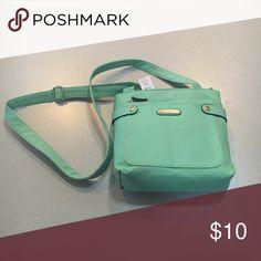 BRAND NEW mint crossbody bag BRAND NEW. Adjustable strap. Mint green crossbody bag. Rosetti Bags Crossbody Bags
