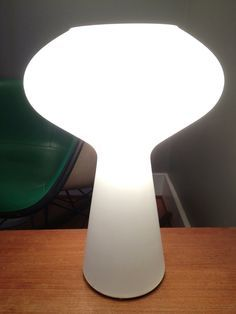 Glass lamp designed by Lisa Johansson-Pape, the most important Finnish lighting designer of the 20th century and certainly one of the most influential in the Modernist period. Dates to circa mid-'60s. Opaque white glass in a groovy yet sophisticated mushroom shape.