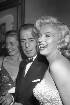 """Marilyn Monroe with Humphrey Bogart & Laren Bacall at the premiere of """"How to Marry a Millionaire"""" in 1953"""