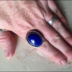 Vintage Navajo Lapis Sterling Silver Ring 8.5 So brilliantly blue! Genuine vintage Navajo (stamped By artist) lapis lazuli ring. In wonderful condition-fits like an 8.5. Tiny golden pyrite flecks scatter along the edges of the stone. Signed dennetdale Navajo Sterling Vintage Jewelry Rings