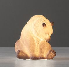 RH baby&child's Bear Porcelain Nightlight:Animals come to life when our porcelain lamps light up. Propped atop a dresser or nightstand, they cast a reassuring glow throughout the room.