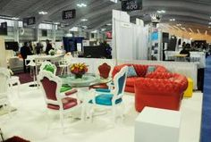 At the Eventbrite pop-up lounge and its own booth, Cort Event Furnishings displayed the company's new Napoleon seating collection, which includes a white vinyl chaise lounge and modern French chairs in six different colors.
