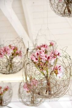 willow orb surrounding spring flowers or live flowers in a tube in a willow orb