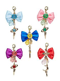 """<div>In the name of the moon! These adorable cellphone charms look just like the bows on the front of the Sailor Senshei's fukus. Sailor Moon, Sailor Venus, Sailor Mars, Sailor Mercury, and Sailor Jupiter; which one will you get?</div><div><br></div><div>Sorry, no choice or returns!</div><ul><li style=""""list-style-position: inside !important; list-style-type: disc !important"""">Approx 1"""" x 1 1/2""""</li><li style=""""list-style-position: inside !important; list-style-type: disc…"""