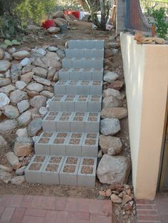 "CINDER BLOCK STAIRS...use dirt and some ""step-able"" plants for a greener area! I'd also add some decking wood with a dark stain to the tops of each step and paint the bricks."