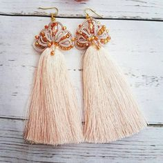Check out this item in my Etsy shop https://www.etsy.com/listing/624234471/rose-gold-dangle-crystal-earrings-bridal