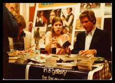 Promoting the movie and signing autographs, way back when.