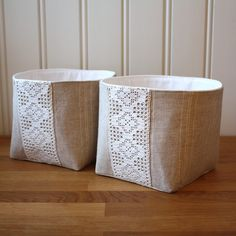 Set of two fabric bins.    These eco chic baskets are made from recycled materials. Exterior is natural colored linen/cotton mix with white pinstripes.