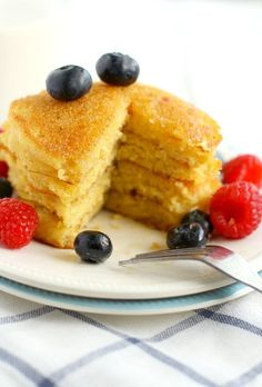 Our new favorite pancake recipe - cornmeal pancakes topped with fresh berries! Easy to make, and perfect for the weekend!