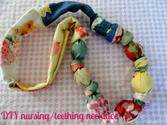 Rachel's Nest: DIY nursing/teething necklace -- I've also seen these made with rubber balls instead of wooden ones