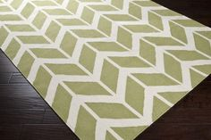 Surya Fallon FAL-1052 Area Rug From delicate lattice patterns to boldly colored chevron patterns the Fallon Collection makes a statement in flat weave; from creator Jill Rosenwald known for her beautifully colored, hand-made ceramics. The Fallon Collection's patterns and the hand woven flat weave construction beautifully combine to highlight its simplicity and sophistication. Fresh and fun patterned rugs with a strong designer color palettes.