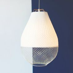 Hanging lamp Open Meshmatics designed by Rick Tegelaar. Open Meshmatics is made of bamboo paper and chicken wire.