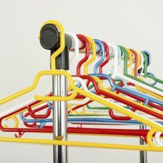 Assortment of plastic hangers on clothing rack