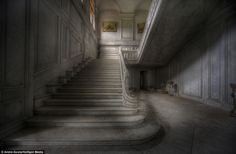 Abandoned: A once grand staircase now stands alone in the beautiful abandoned mansion. Round Mansion in Belgium was discovered and photographed by urban explorer Andre Govia. The nine bedroom mansion was abandoned sometime in the early 1990s.