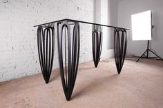 Table, steel powder-coated legs and glass top, 2017