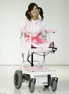 Disabled model Ami Sano presents creations by designer Takafumi Tsuruta from his Spring/Su...