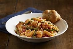 Shrimp and Asparagus Penne - Sautéed shrimp with garlic and fresh asparagus tossed with our marinara and fresh basil and finished with Parmesan cheese and toasted bread crumbs.