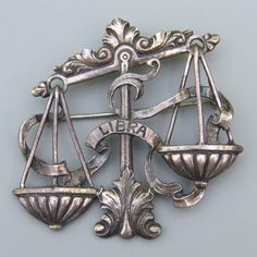 """This large vintage sterling silver brooch by Cini is from the Zodiac series. Beautifully designed and crafted, the scales of justice, la balance, are the symbol for those born under the seventh sign of the zodiac, the sign of Libra, between approximately September 23 and October 22 (depending on the year). The pin measures 2"""" high x 2 1/8"""" wide and has a wonderful rich patina"""