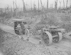 """Caterpillar drawing an 8"""" howitzer of the 126th Siege Battery, past Bernafay Wood, Montauban-Longueval road. September 1916."""