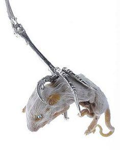 Julia deVille. Object: Prey, 2004. Sterling silver, mouse, natural topaz. 9 x 4 x 2cm.
