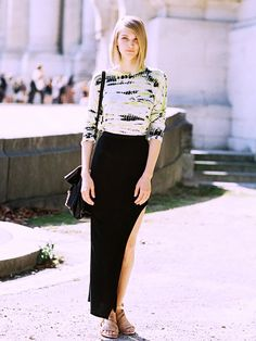 The off-duty model paired a tie-dye shirt with a slit skirt and sandals. The result? An insanely chic weekend outfit. // #Fashion