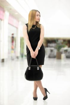 Attractive young woman wearing black color scheme clothes: little dress high heel shoes holding suede handbag in outlet Suede Handbags, Perfect Little Black Dress, Black High Heels, Little Dresses, Wearing Black, Free Photos, Women Wear, Shoes Heels, How To Wear