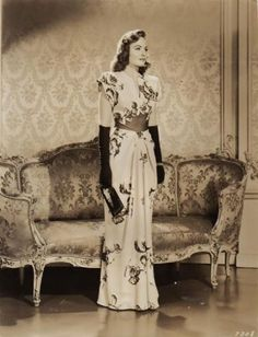 Donna Reed. 1940s glamorous evening wear, evening dress floral gown rayon photo print ad vintage fashion movie star gloves purse hair