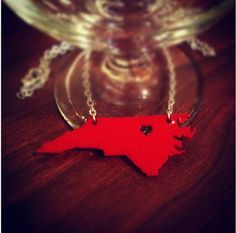 NC State Necklace Heart over Raleigh, North Carolina. These would be perfect for parties, identifying who's is who's!