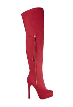 Take sexy to new heights this season in Ballantine by JustFab. She's a totally luscious heeled over-the-knee boot featuring an outer gold zipper with studded tassel detail.