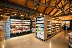 Exposed steel trusses, restored wood ceilings, rugged brick and polished concrete frame a masterful merchandising program and a dynamic shopping experience.