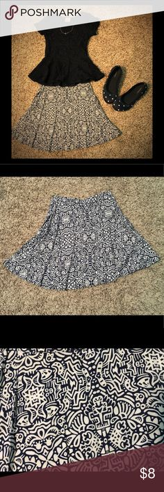Navy and White Graphic Print Skirt Navy and white graphic print skirt. Fits at waistline, not at the hips. Very good condition! No holes or stains! Very cute and flowy. Looks good with my navy flowered lace peplum top! Nanette Lepore Bottoms Skirts