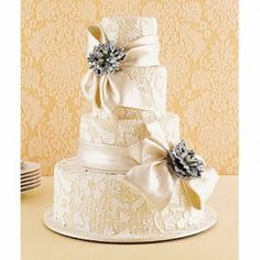 Lace wedding cake, the lace and ribbon are edible. How lovely! I love this cake and this idea! If I looked around more at cakes I would have loved this cake for my wedding! I could have used the lace design from my wedding dress! Ivory Wedding Cake, Beautiful Wedding Cakes, Gorgeous Cakes, Pretty Cakes, Dream Wedding, Wedding Day, Gold Wedding, Purple Wedding, Amazing Cakes