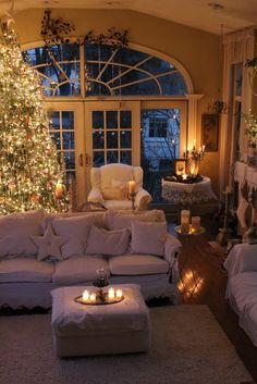 Oh, so cosy! I would like to sit in this beautiful, elegant room and tell stories around the fire (with all the lights off except for the Christmas tree, of course)