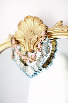 Necklaces on a mirror