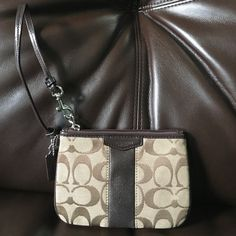 NWOT % Coach Mini Wristlet NWOT ✨Super cute brown Wristlet. Excellent condition! No stain or holes!! ✨Lmk if you have any questions!! Not included for The Spring Sale!! Make me a reasonable offer by pressing the offer button. ❌Not trading❌ Coach Bags Clutches & Wristlets