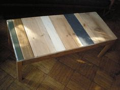 Love this table made from discarded and used timbers.