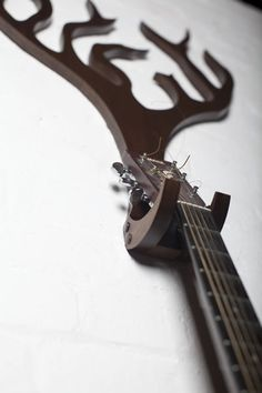 Guitar Hanger by Design Jazz This wall mounted guitar hanger was inspired by nature and folk music.