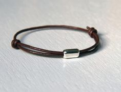 Sterling Silver Cylindrical Bead Leather Bracelet.