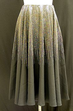 Halston 1970. Wow, that must have taken forever to embellish, assuming it was done by hand.