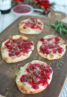 Warm Brie Cranberry Naan is a festive, naan-traditional holiday appetizer. Mini naan bread is topped with warm, creamy brie cheese, a sweet cranberry sauce, and finished off with freshly chopped rosemary.// A Cedar Spoon AD