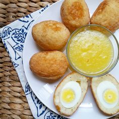 Guyanese things.  This is a snack straight out of my childhood: Eggball with Spicy Mango Sour(chutney). Hard boiled eggs are encased in creamy cassava then fried until golden 😍😍. When is the last time that you had one of these??? #eggball #guyanesefood #snack #weekend #homemade #bestfoodworld #eattheworld #vscofood #vscocam #foodpic  #buzzfeast #foodstagram #foodporn  #island360  #picoftheday  #instafood #instalike #beautifulcuisine #guyana #Guyanese #delicious #yummy