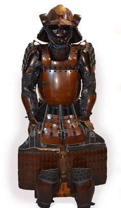 Japanese samurai armor, lacquered iron, nuriwake gomai do tosei gusoku type, and lacquered in two colors: dark brown and light brown. It is a complete set with : a yukinoshita style do, a suji bashi helmet with 18th plates, a shikoro with 5 plates laced in sugake odoshi style, and a ryubu type menpo with yadome.