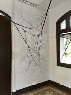"""Artist Janaina Mello Landini (previously) continues to produce dizzyingly complex installations and canvas-based sculptural works comprised of unbraided ropes that branch out like tree roots. The fractal-like artworks have developed over a period of six years as part of her """"Ciclotrama"""" series, a wo"""