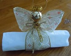 Ribbon angel napkin ring turns into an ornament when dinner is done