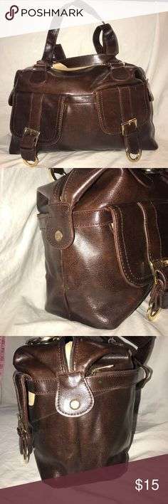Muska Italian Leather Vintage Satchel Damaged Dark brown smooth leather large bag with two main pocket divided by a zip pocket. It has a wall zip pocket and two wall slip pockets. The main zipper is missing on this. The front has two small pockets with flap snap closures. The back has a zip pocket. The bag shows normal wear. The bag snaps on the sides. The main zipper is missing the zipper pull and the leather where the straps attach is somewhat torn on one strap. Muska Bags Satchels