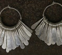 Earrings | Megan Stelzer. Sterling silver. Reminds me of the earrings I made in high school. Need to make more hammered dangles.