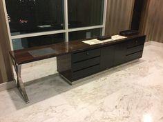 High gloss table and black croco design at Botanica Apartment Jakarta by Simple Luxury Interior Surabaya, Indonesia