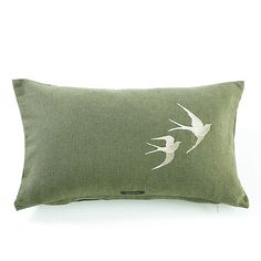 Moss green cushion with embroidered swallow